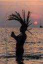 Young Rastafari Male Playing in tropical island Su Royalty Free Stock Photo