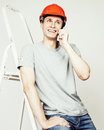 Young real hard worker man isolated on white background on ladder smiling posing, business concept