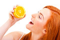 Young red hair woman with oranges in her hands over mouth Royalty Free Stock Image