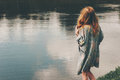 Young red hair woman walking at river alone Royalty Free Stock Photo