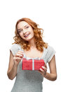 Young red-haired happy smiling girl holding gift Stock Images