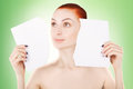 Young red haired woman with white paper, green background Royalty Free Stock Photo