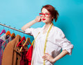 Young redhead designer with metric and clothes Royalty Free Stock Photo