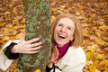 Young redhead woman with autumn leaves laughing Stock Photos