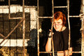 Young redhead woman behind bars Stock Photo