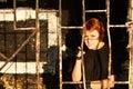 Young redhead woman behind bars Stock Photo