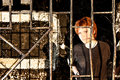 Young redhead woman behind bars Stock Images