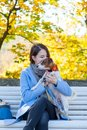 Young redhead woman in blue dress with pet Royalty Free Stock Photo