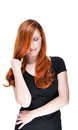 Young redhead woman feeling fragile beautiful embracing herself and playing with the hair on a white background Royalty Free Stock Photography