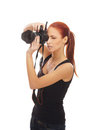 A young redhead woman holding a photo camera Stock Photo