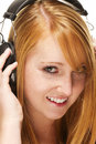 Young redhead woman listening to music Royalty Free Stock Image