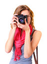 Young redhead woman looking through viewfinder with an old mm slr camera Stock Photo