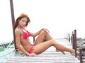 A young redhead woman posing in a red swimsuit Stock Image