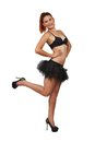 Young redheaded girl in black bra and tutu isolated on white Royalty Free Stock Photos