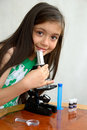 Young researcher analyzes with a microscope Royalty Free Stock Photos
