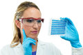 Young researcher examining a microplate laboratory woman well in hand Stock Photos