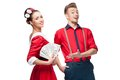 Young retro couple holding money Royalty Free Stock Photography