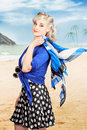 Young retro woman on a tropical beach vacation pretty dressed in style illustration photograph composite background Stock Photo