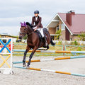 Young rider girl on horse show jumping competition Royalty Free Stock Photo