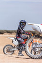 Young rider on a motorcycle through the desert area summer day Royalty Free Stock Photography