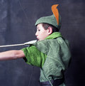 Young robin hood drawing bow arrow Royalty Free Stock Photos
