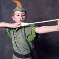 Young robin hood drawing bow arrow Royalty Free Stock Photo