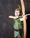Young robin hood drawing bow arrow Stock Image