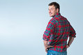 Young robust casual man on a grey background Royalty Free Stock Photos