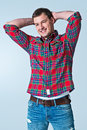 Young robust casual man on a grey background Royalty Free Stock Image