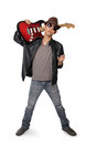 Young rocker carrying guitar on his shoulder, isolated on white Royalty Free Stock Photo