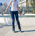 Young Roller Girl is learning how to skate