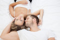 Young romantic couple in bed lying together Royalty Free Stock Image