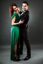 Young romantic couple dancing tango full length portrait of beautiful elegant dancers gray background Stock Photography