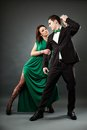 Young romantic couple dancing tango full length portrait of elegant dancers gray background Stock Images