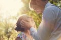 Young romantic couple flirting in sunshine vintage love dating romance flare Royalty Free Stock Images