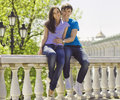 Young romantic couple sitting in park enjoying themselves outdoor Stock Photography