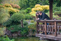 Young romantic couple standing on the bridge looking on the water Royalty Free Stock Photo
