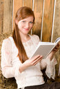 Young romantic woman in barn hold book Stock Images