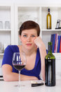Young sad thinkful woman drinking a glass of red wine Royalty Free Stock Photos