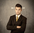 Young sales guy with arrow in the head Royalty Free Stock Photo