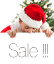 Young Santa Claus holding empty banner Stock Photo
