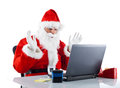 Young santa claus with notebook on white background Stock Photo