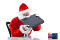 Young santa claus with notebook on white background Royalty Free Stock Photo