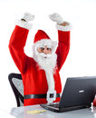 Young santa claus with notebook on white background Royalty Free Stock Photography