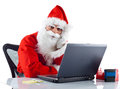 Young santa claus with notebook on white background Stock Images
