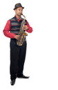 Young saxophonist a man plays his saxophone whilst standing upright Royalty Free Stock Image