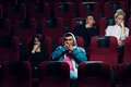 Young scared adults watching horror movie Royalty Free Stock Photo