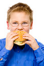 Young  school boy eating hamburger Stock Image