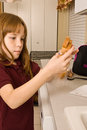 Young school girl preparing her lunch peanut butter jelly sandwich Royalty Free Stock Photos