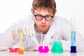 Young scientist doing chemical reactions in the laboratory studio shoot Stock Photos